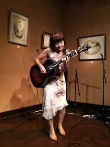 emmy plays guitar